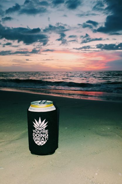 Black Pineapple Koozie on Beach